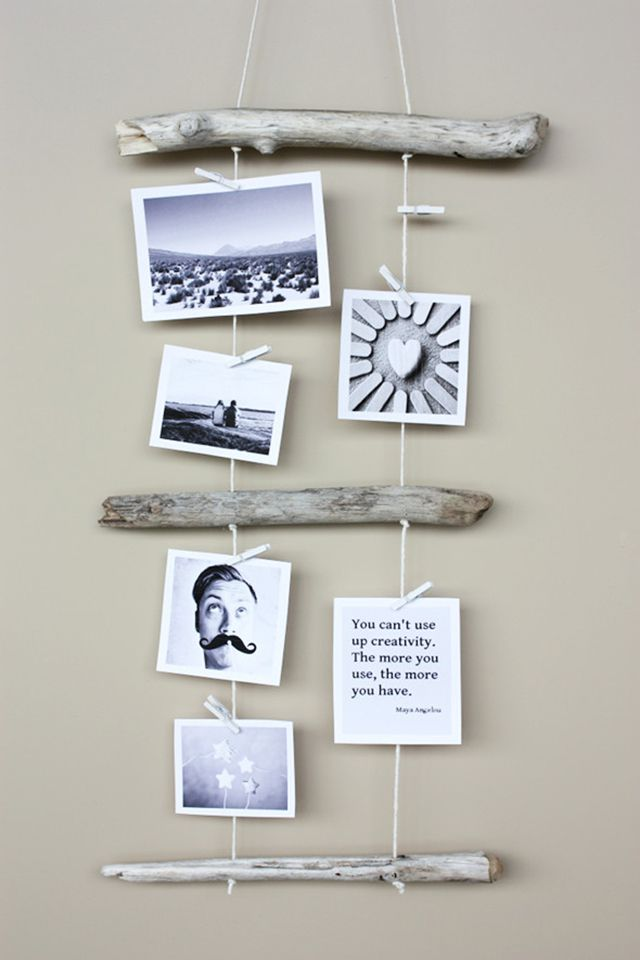 Hanging collage of photos tied together with driftwood.