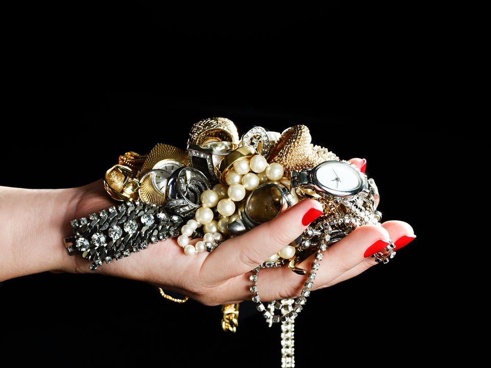 Woman holds various jewelry