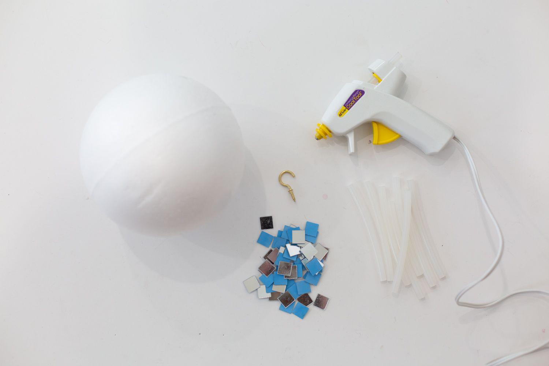 Gathered materials to make a DIY disco ball