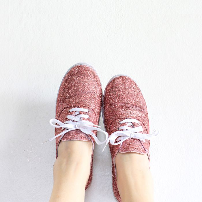 A woman's feet with pink glitter sneakers