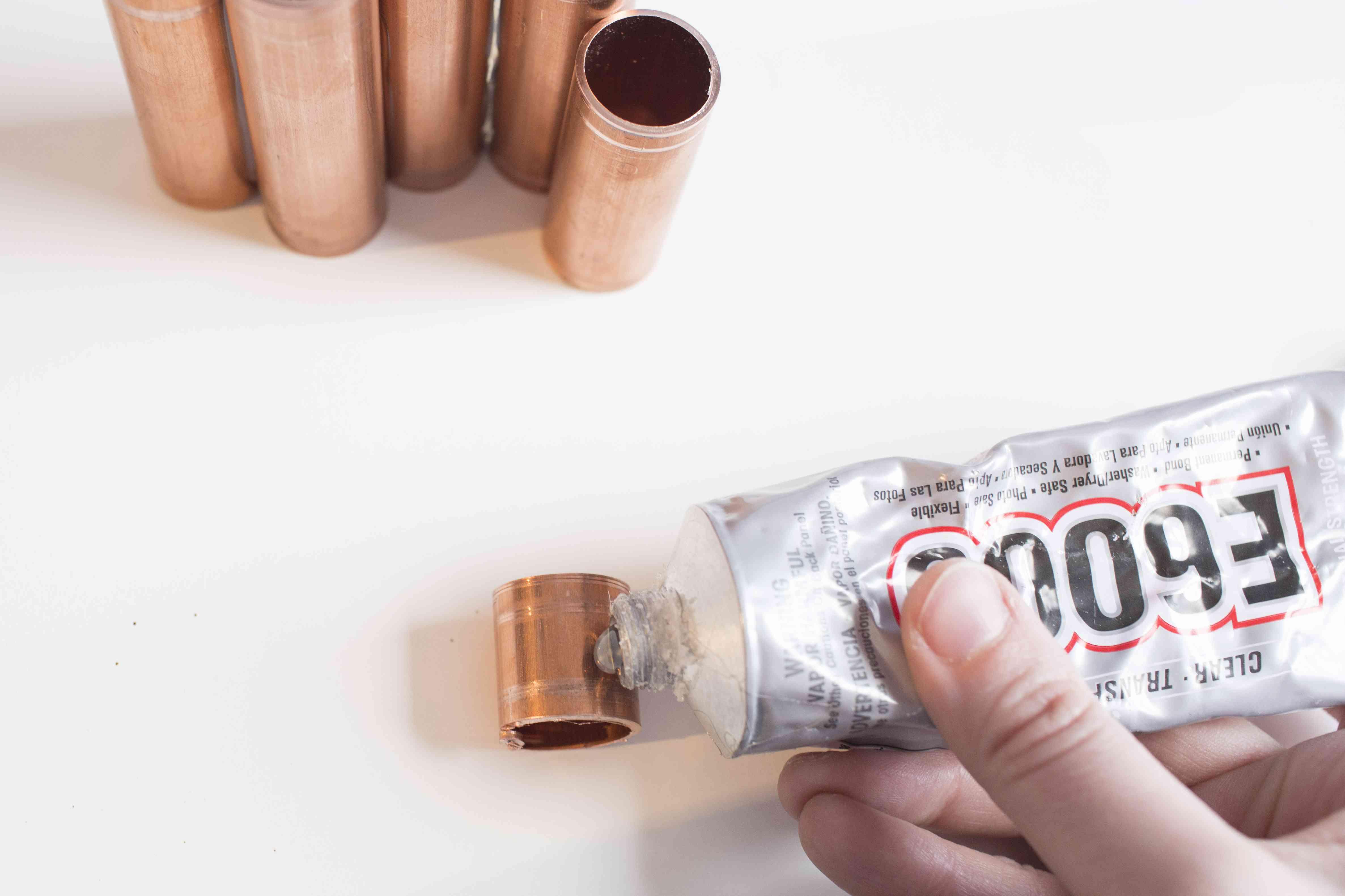 Using E6000 glue on the copper pipe pieces
