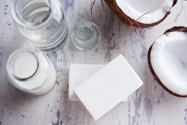 Coconut soap with a split coconut and coconut oil