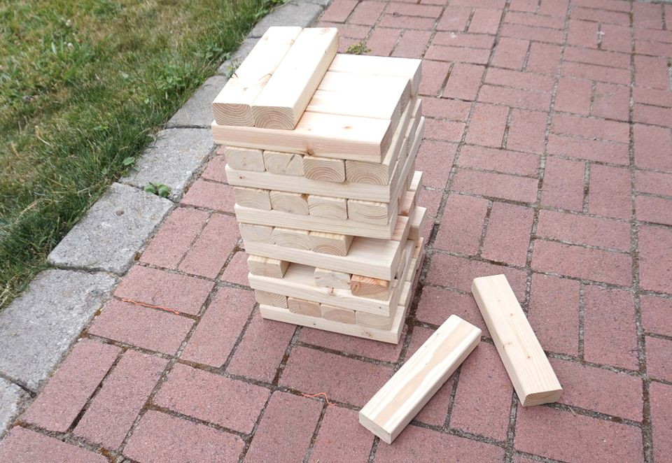 Giant Jenga set with a few blocks pulled out