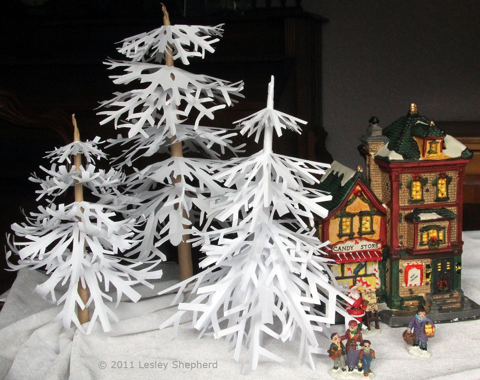 Snowflake trees in a miniature Christmas village