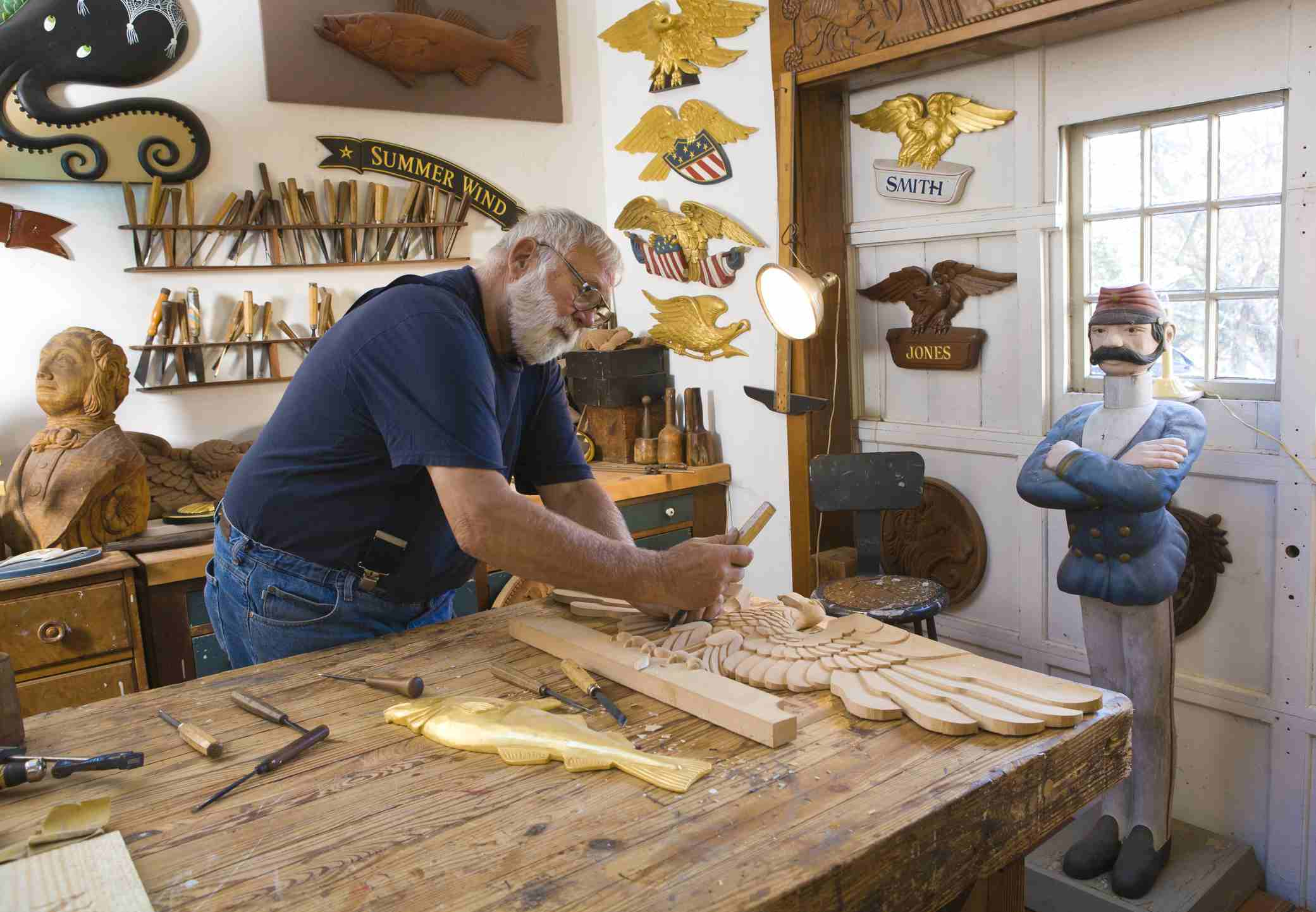 A woodcarver working in his shop