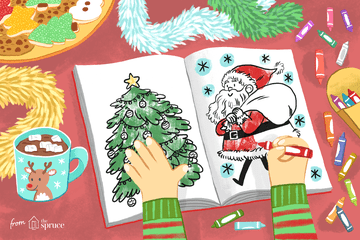An illustration of a child's hands coloring two Christmas coloring pages on a table with crayons and cocoa and holiday cookies