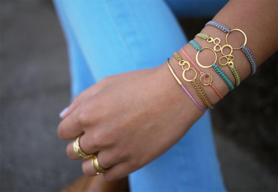 A woman wearing lots of macrame bracelets