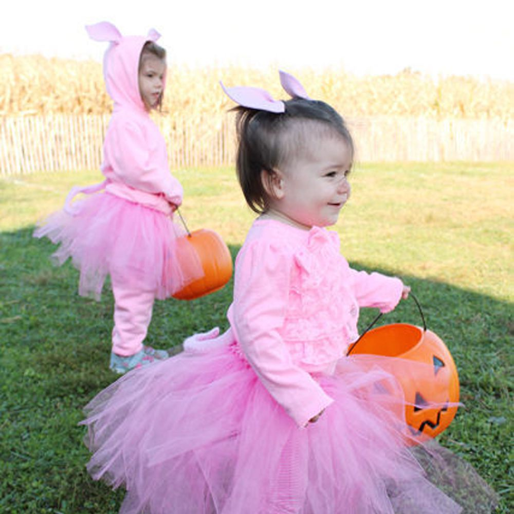 Two toddlers dressed in pink tutus