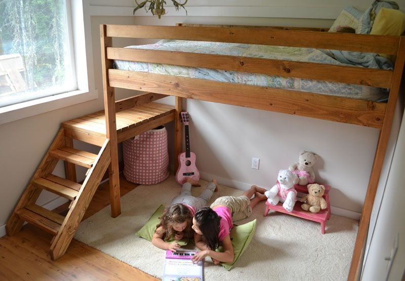 A Wooden Loft Bed With Stairs