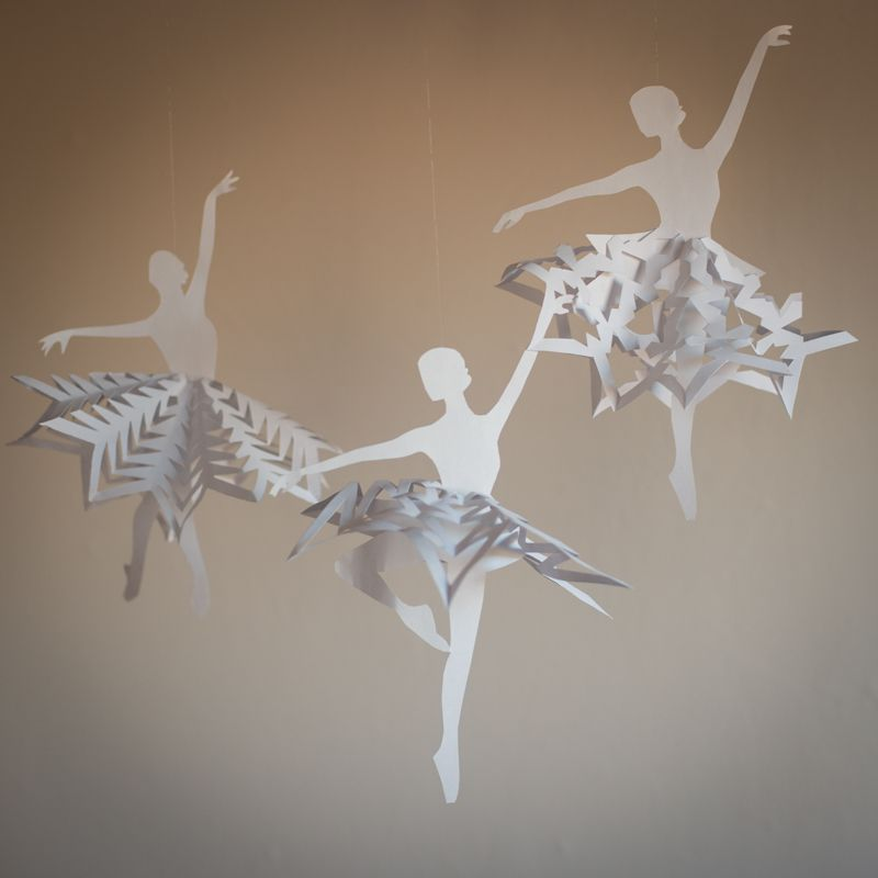 three ballerina snowflake templates hanging from strings