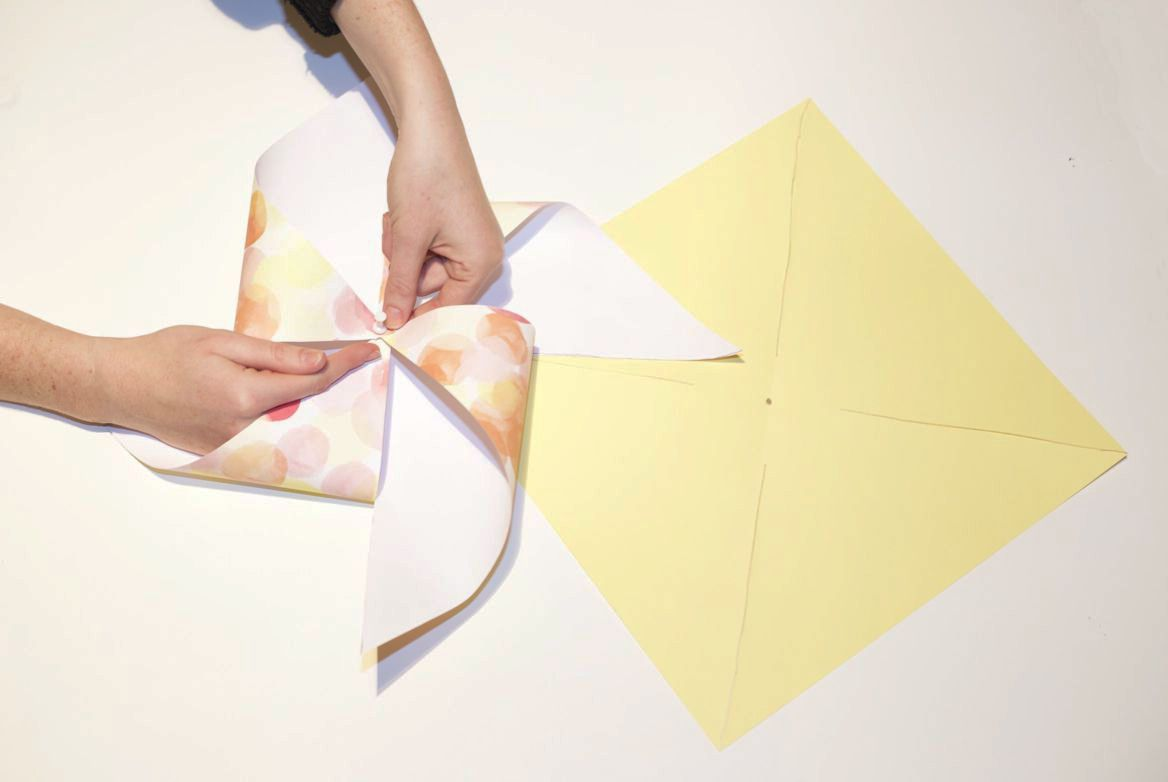 Pinning paper corners in the center