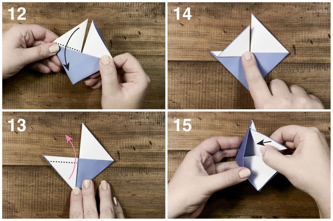 Inserting corners to create an origami sailboat.