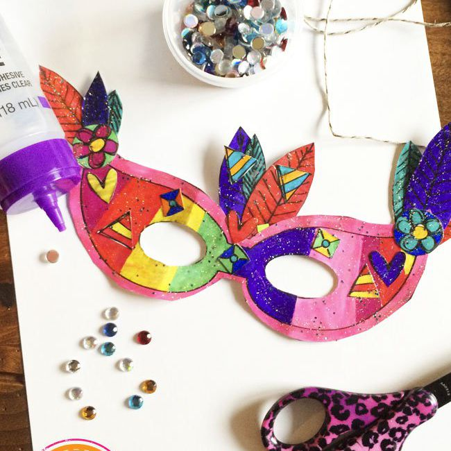 A Mardi Gras mask and decorating supplies
