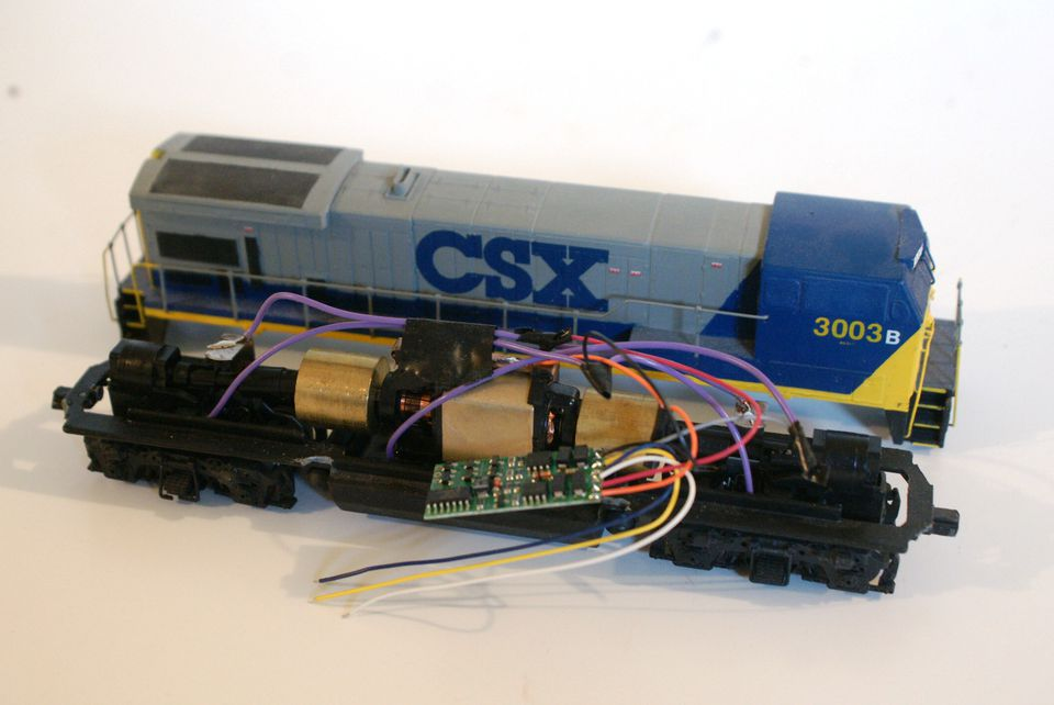 NCE decoder installed on an Athearn HO locomotive frame and motor