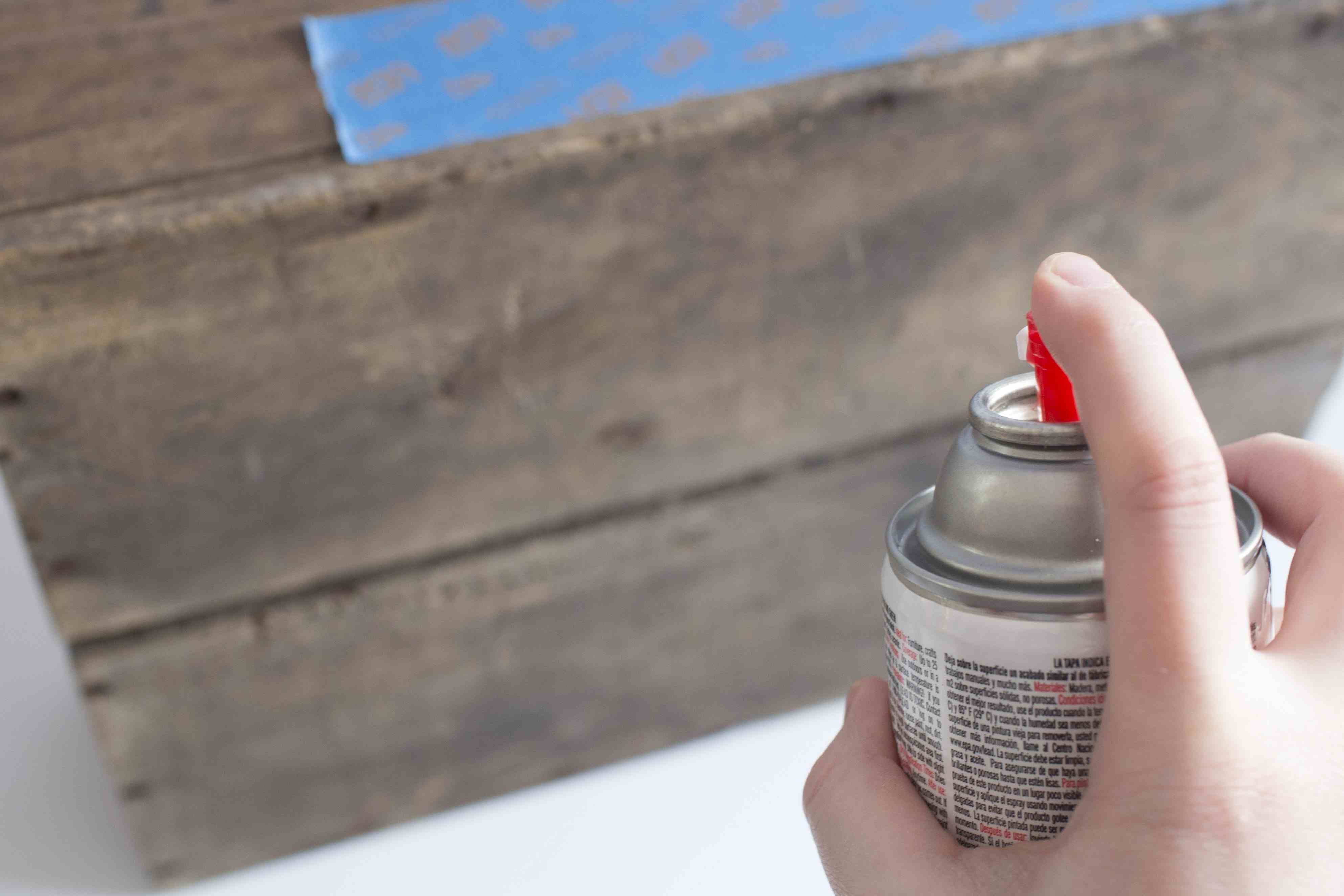 Spray painting a wood crate