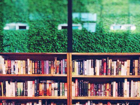 under window bookcase built books in shelf against glass window tutorial on building an under bookcase