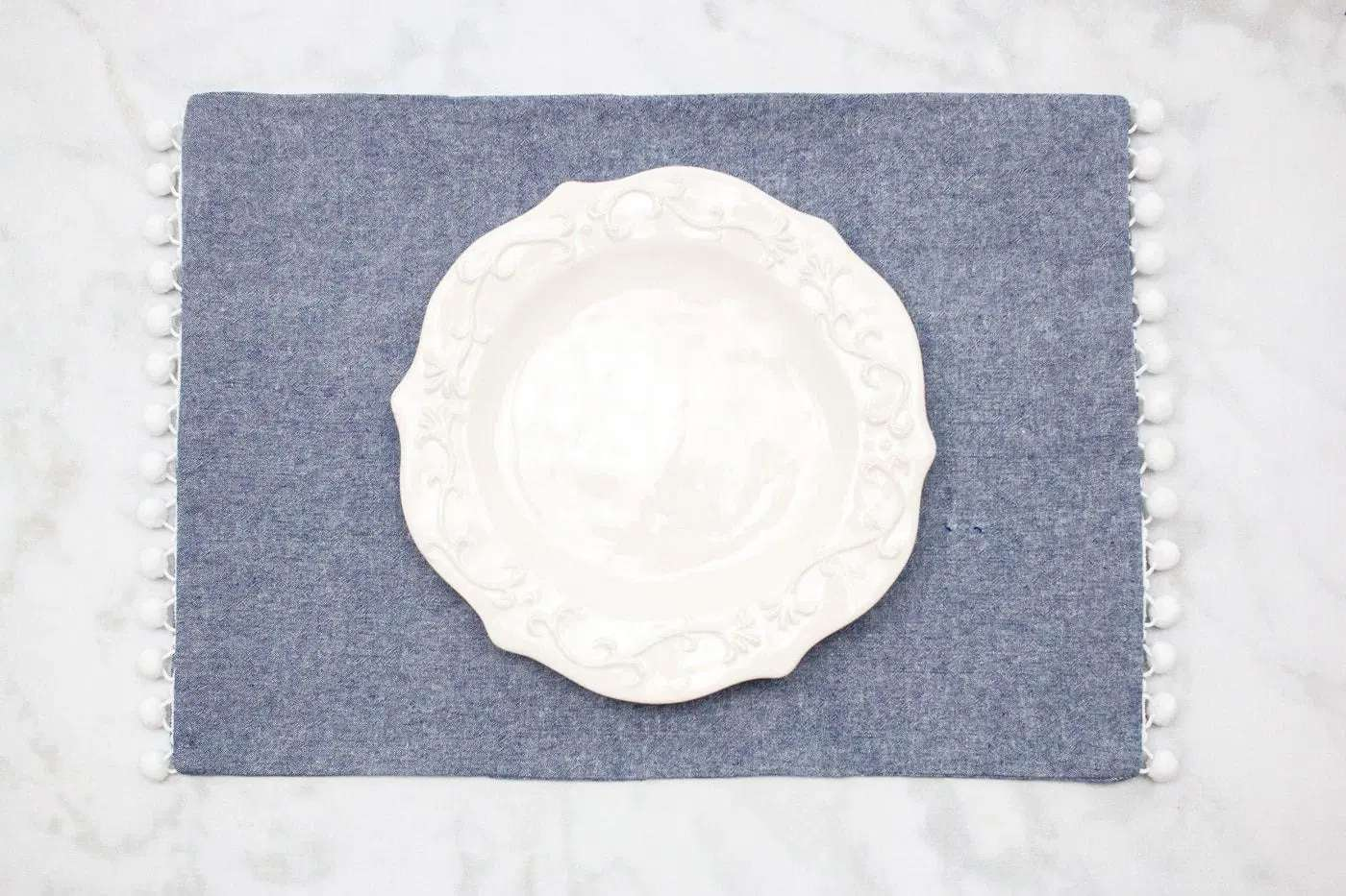 A blue place mat with white trim