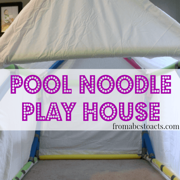 Pool noodle play house with yellow noodles for base, blue noodles for arch, and white linen for the sheet.