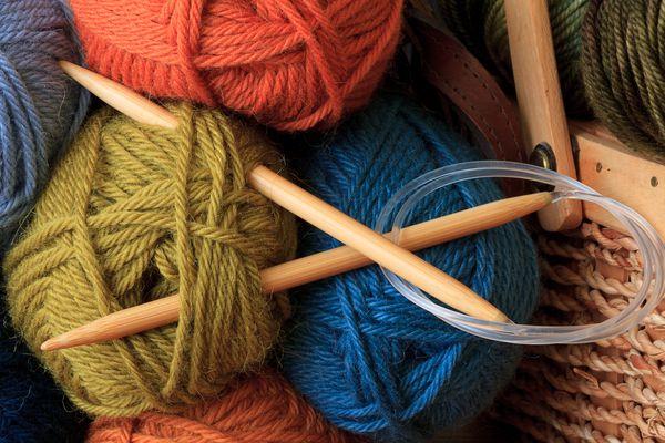 Circular knitting needles in a pile of yarn.