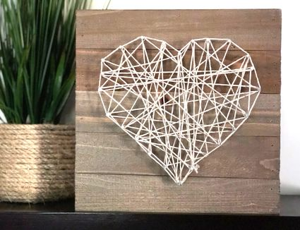 heart string art and plant