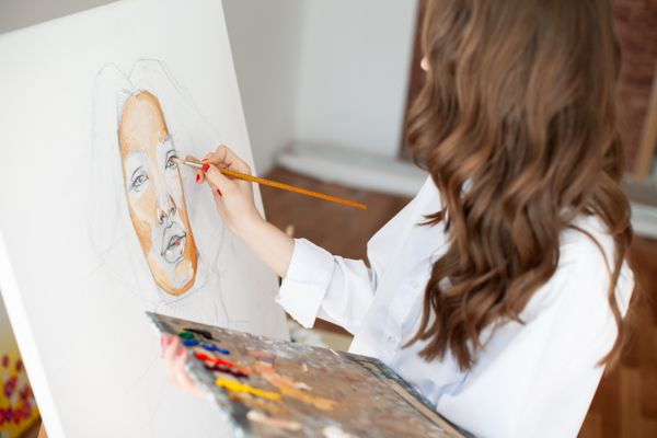 Young girl painter at artwork process