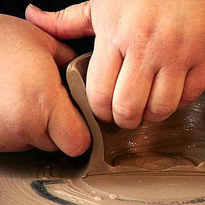 Cut-Away illustrating the proper hand position when throwing on pottery wheel