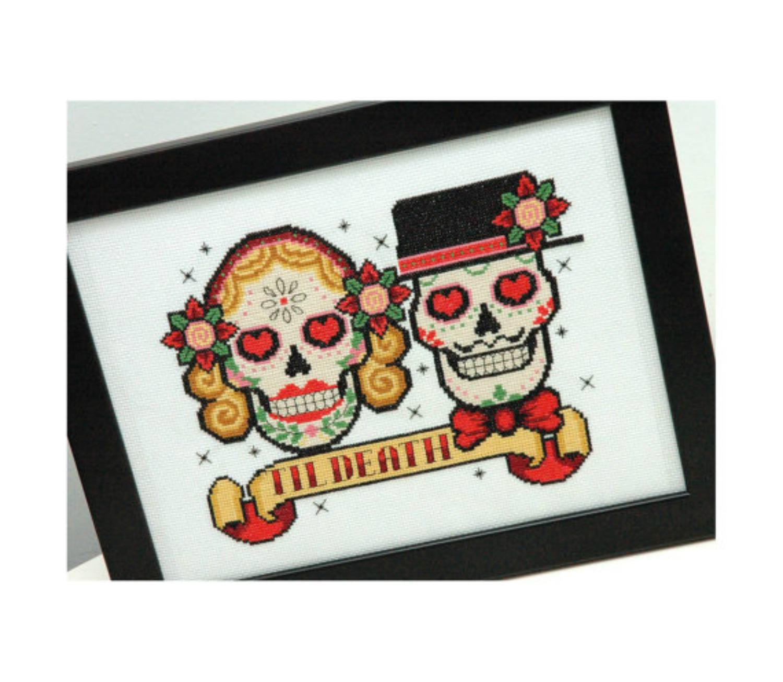 Cross-stitch skeleton heads