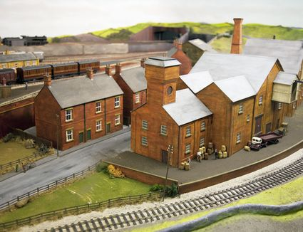 Model train with street and grass town scenery