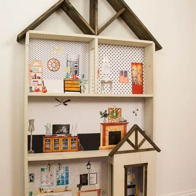 A dollhouse glued to a wall