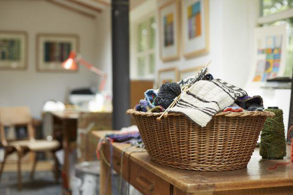 Basket of knitting in artists studio