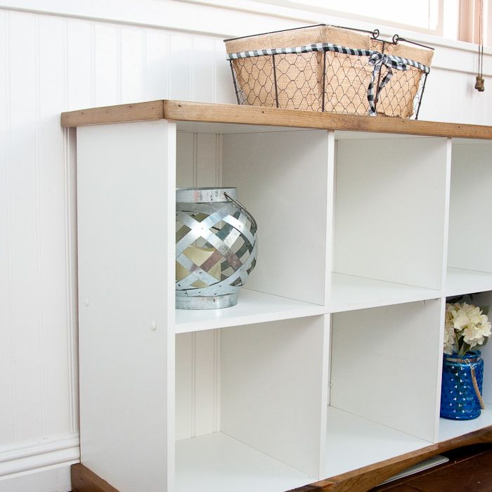 A white console table with shelving