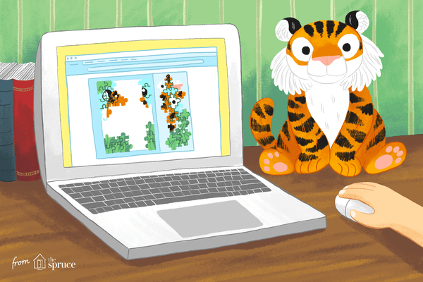 An illustration of a laptop screen and a child's hand on the mouse playing with an online puzzle. A tiger stuffed animal is next to the screen