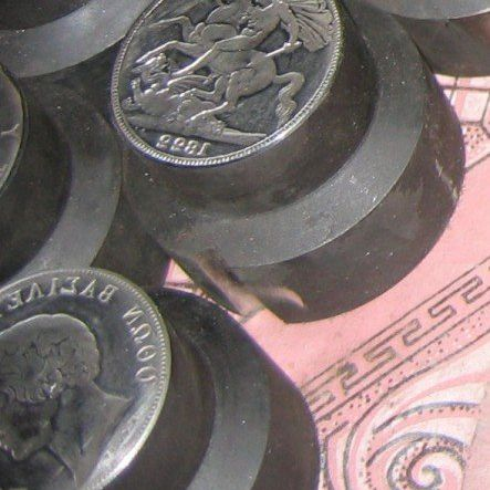 Close-up photo of the dies used by a Chinese coin counterfeiting ring.