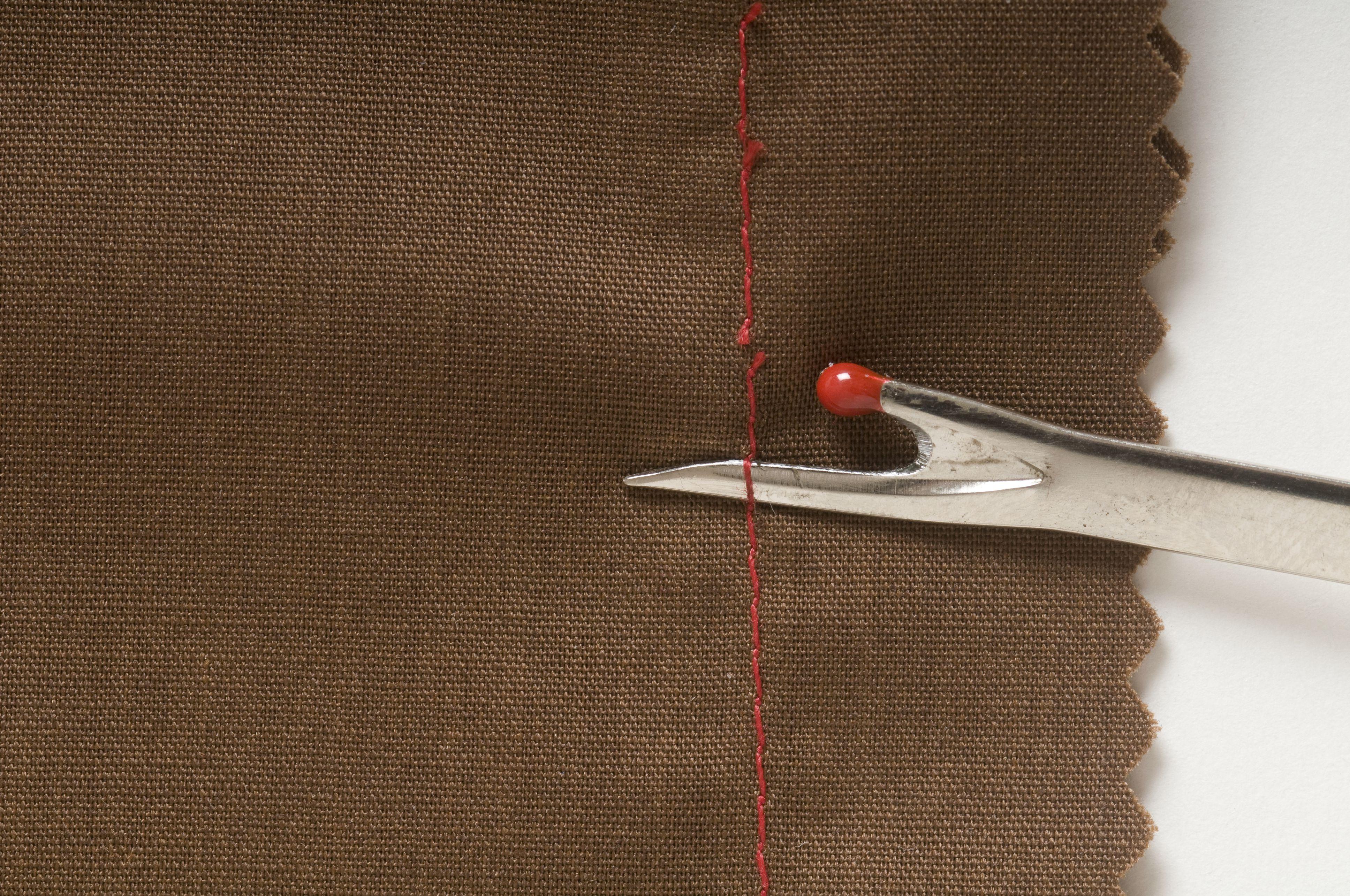 unpicking stitches with a seam ripper