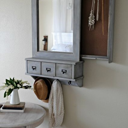 A hanging mirror with a secret jewelry compartment