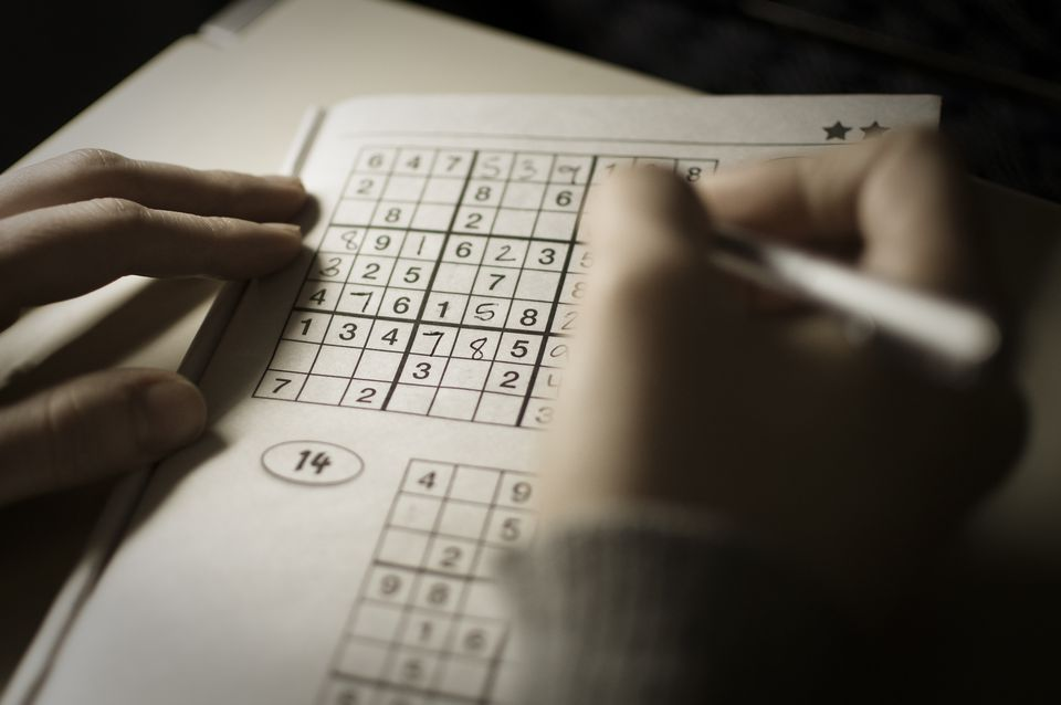 Someone playing Sudoku
