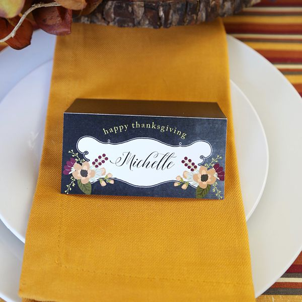 black place card with fall florals
