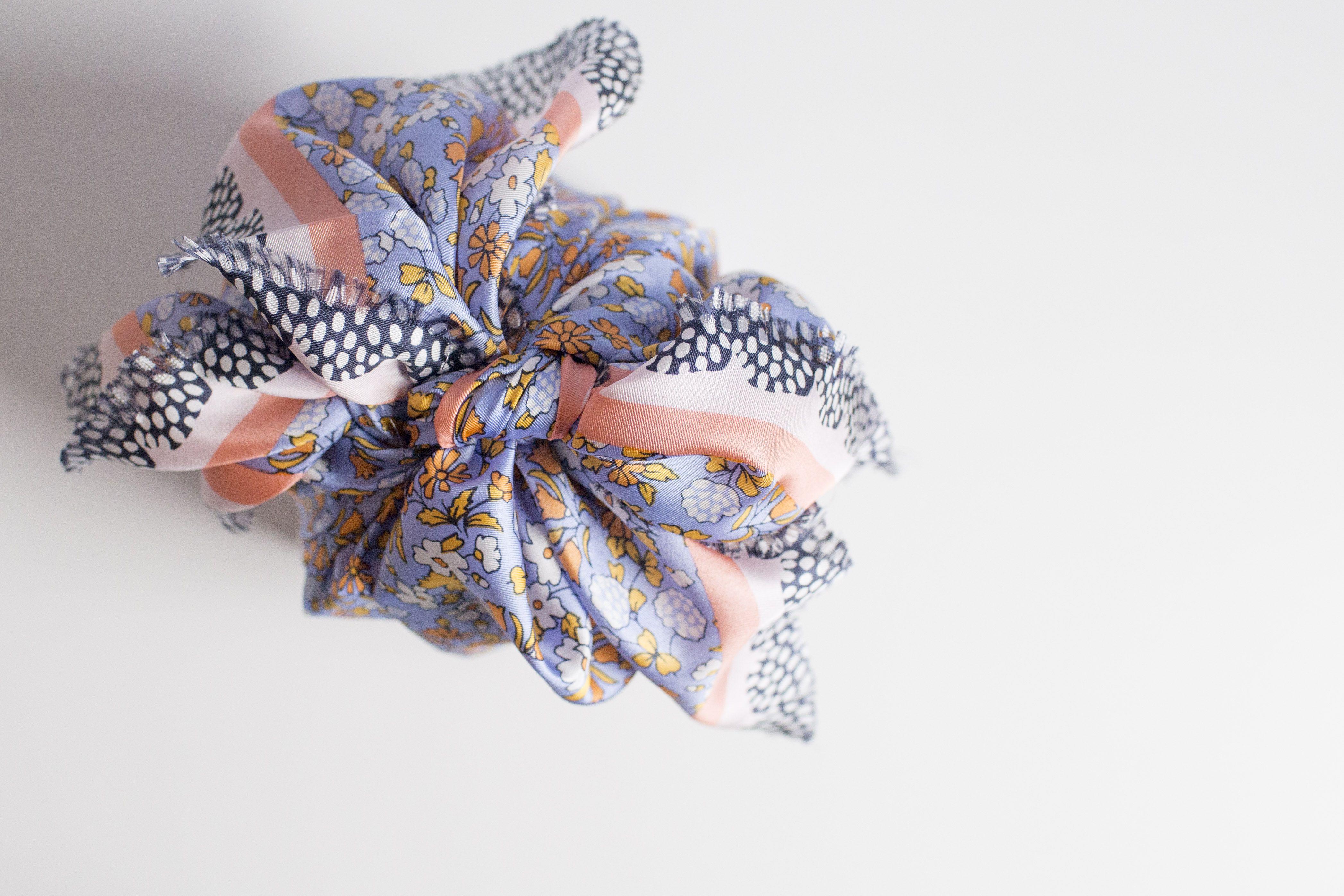 Tie corners into knot for furoshiki