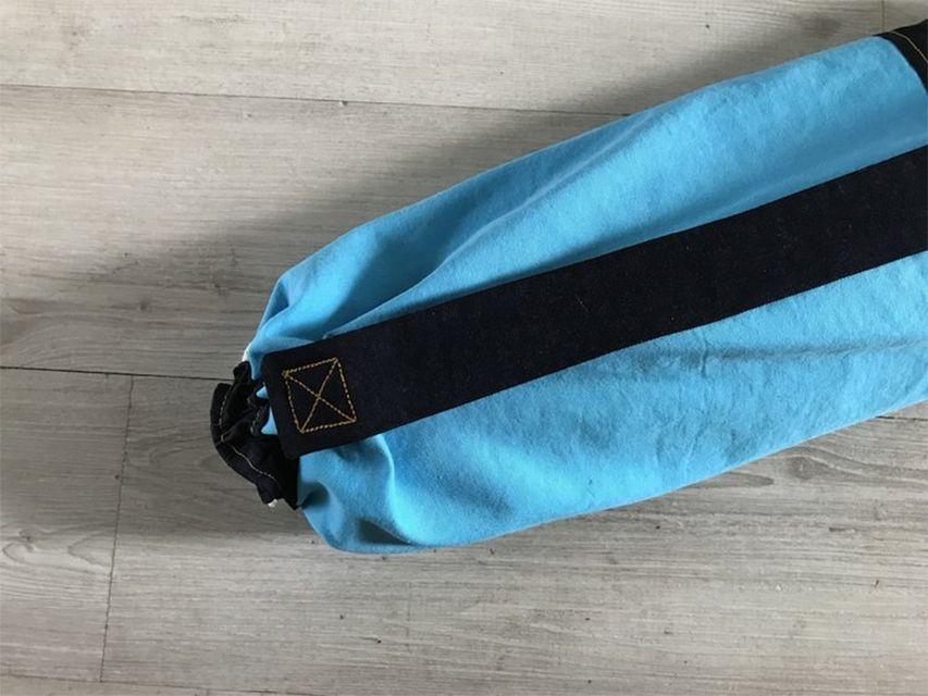 A blue and black yoga mat bag