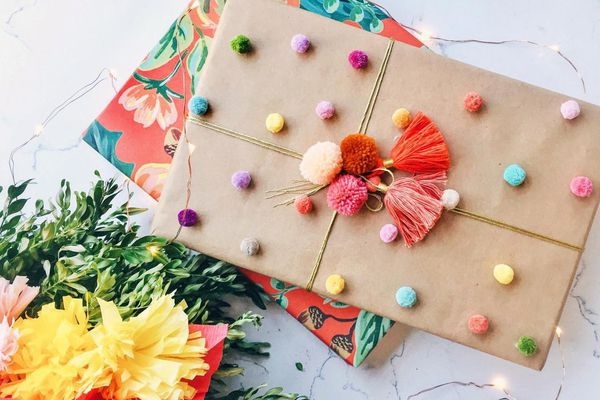 Two wrapped presents on white marble background