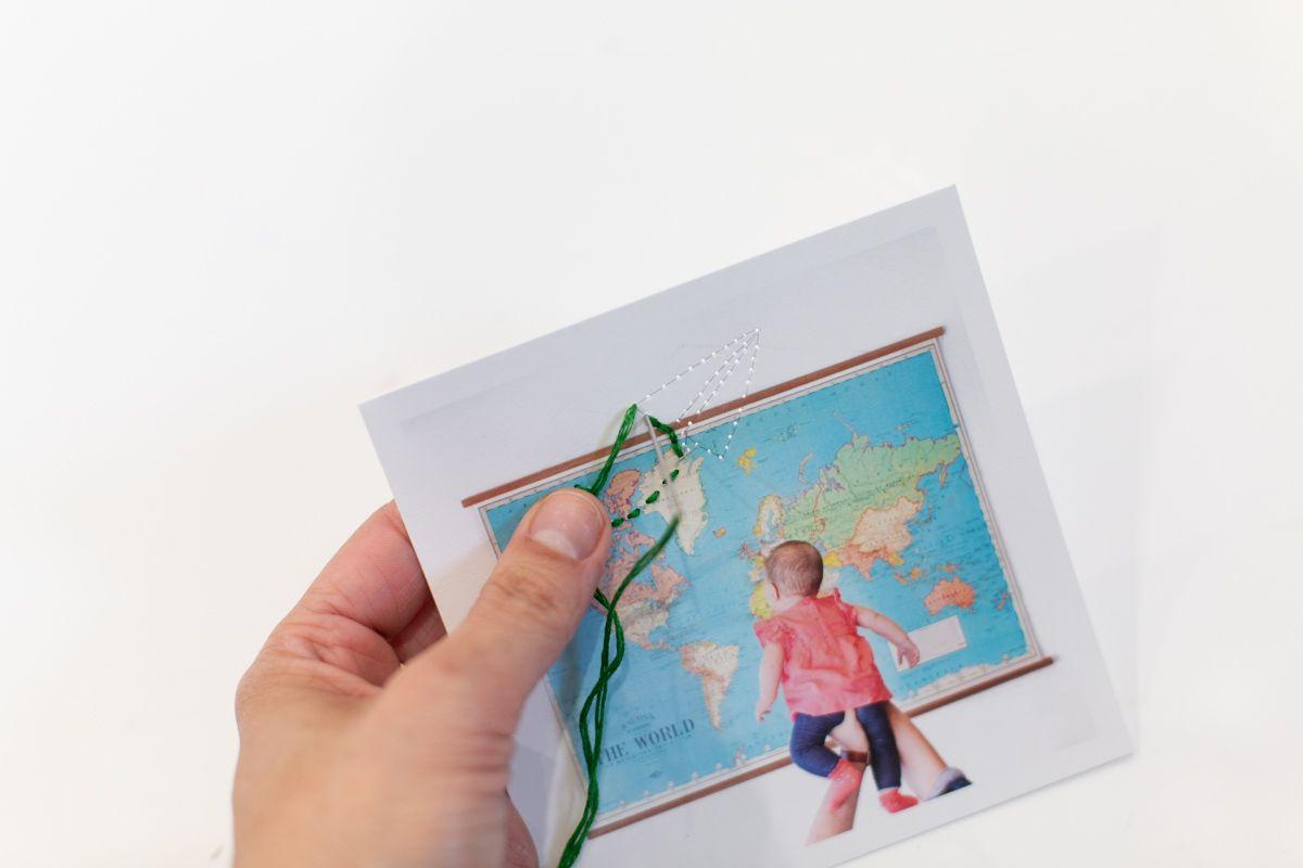 Backstitch embroidery on a photograph
