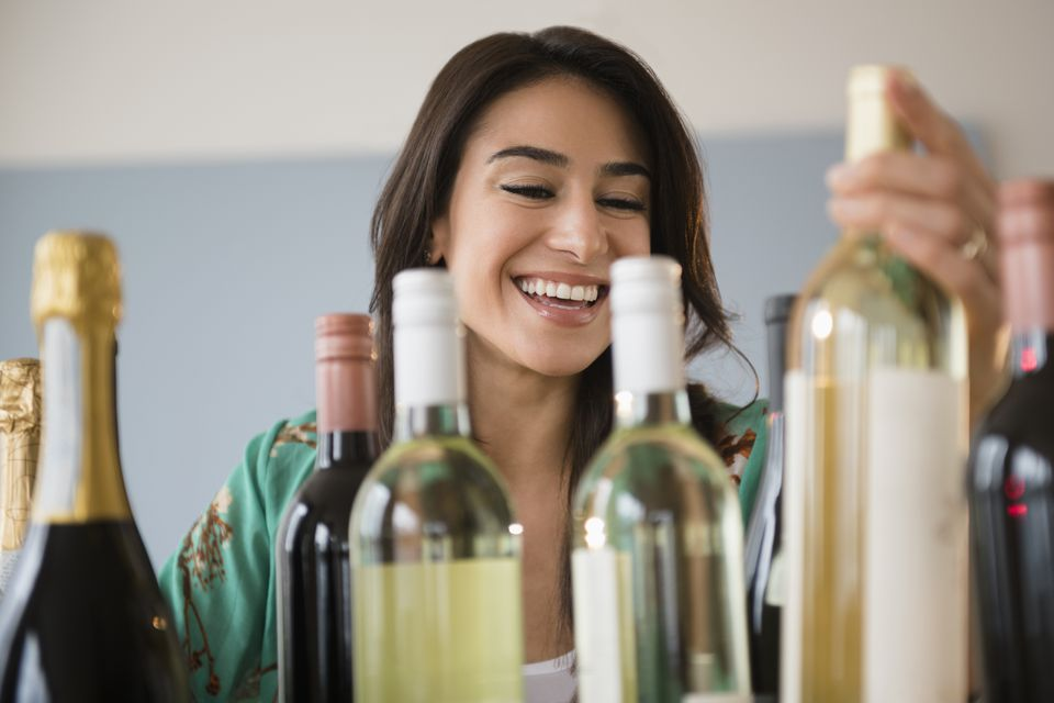 Woman choosing bottle of wine
