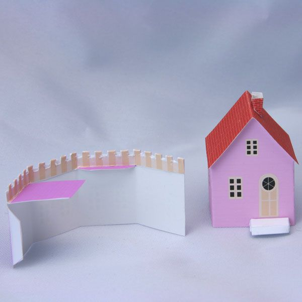 A simple cottage and crenellated addition, printable miniatures for a Putz Christmas N scale train.