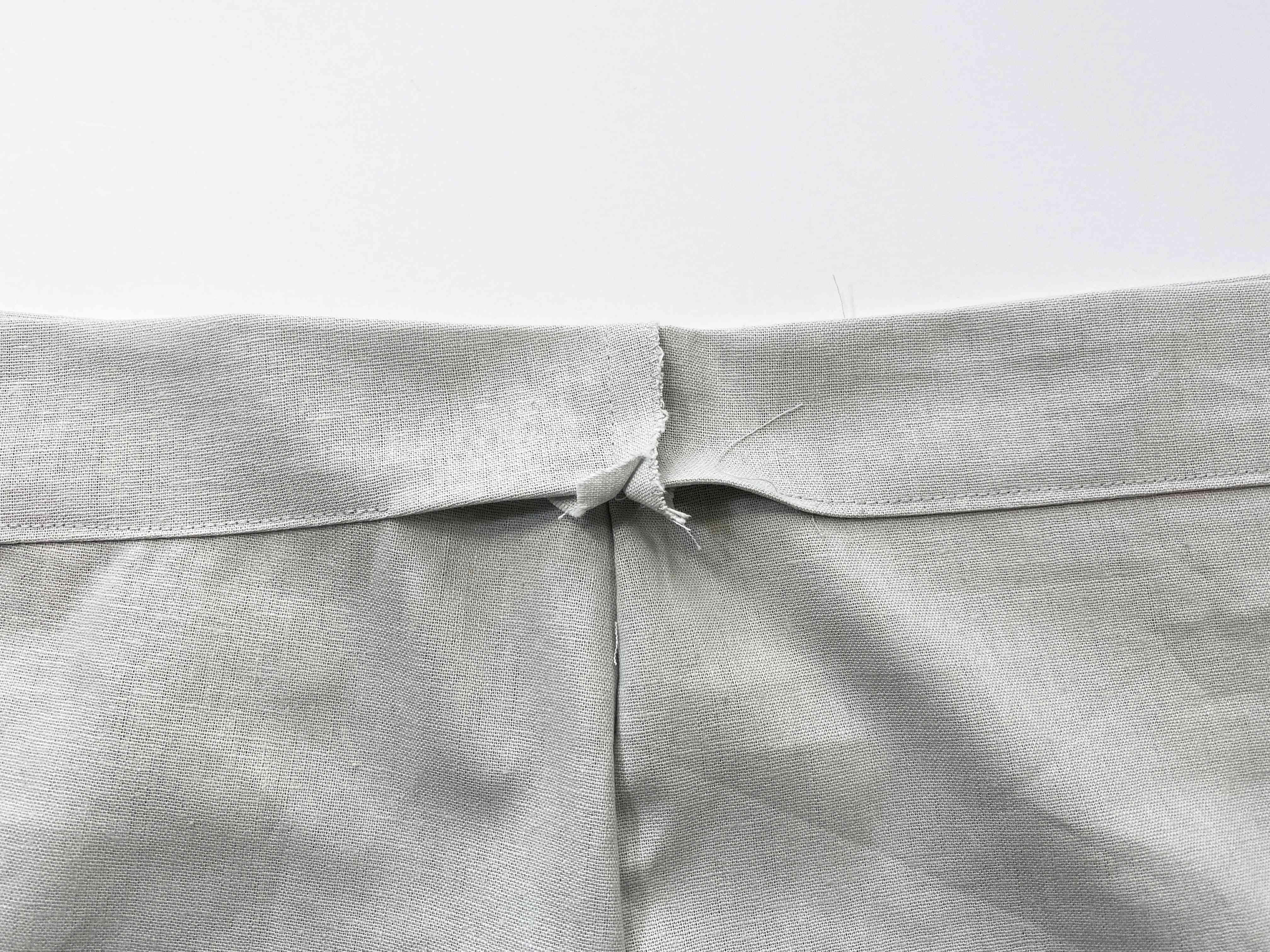 A partially sewn waistband
