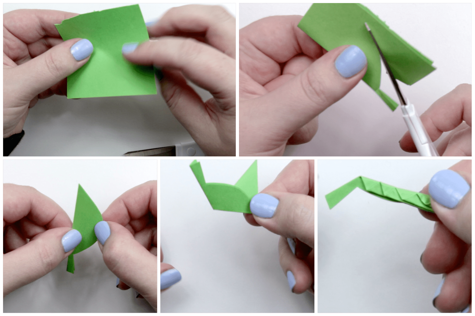 Shaping the leaf design out of the green paper.