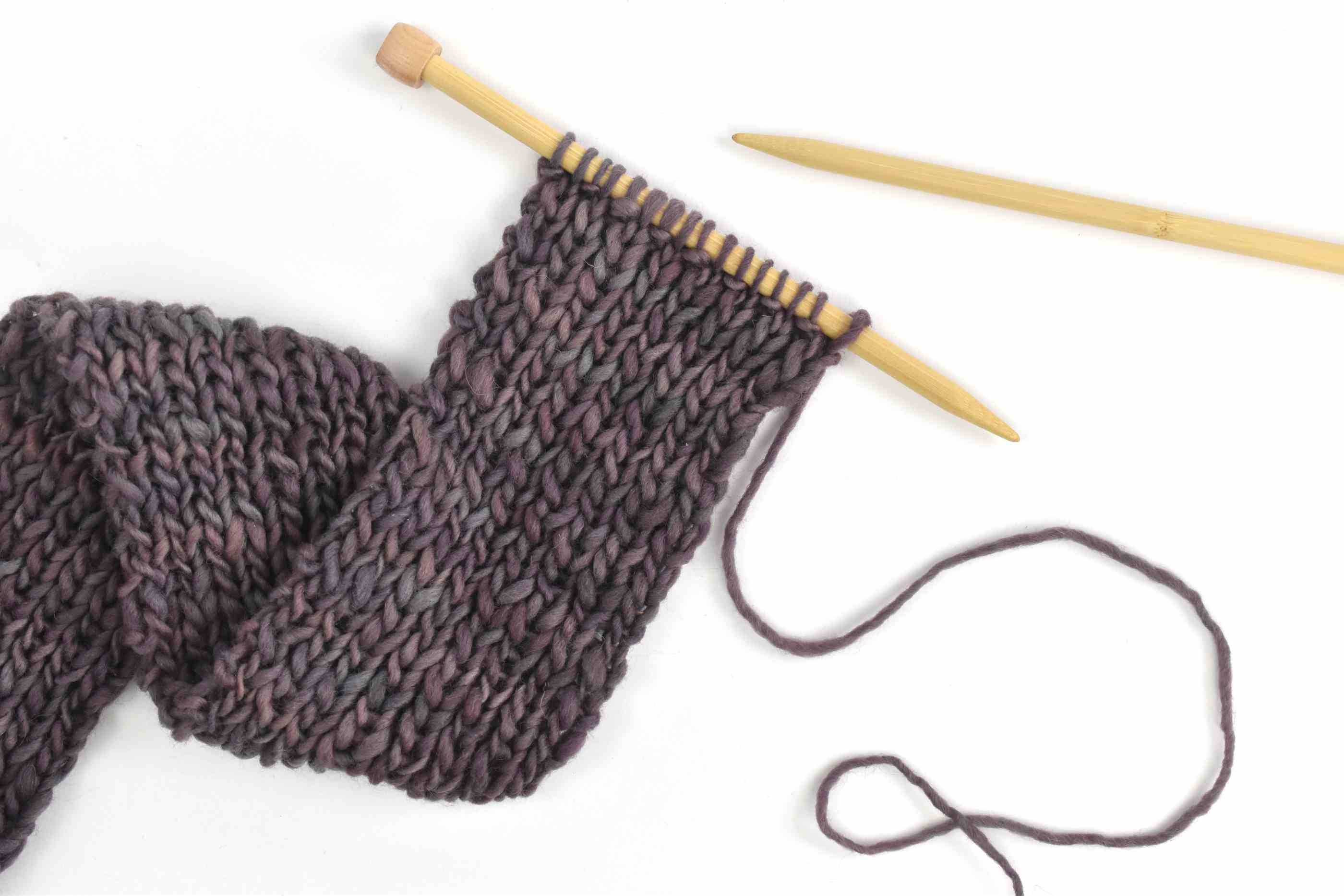 Scarf in-progress with knitting needles