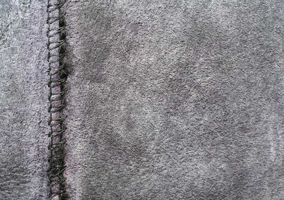 Zigzag connecting seam on gray fabric