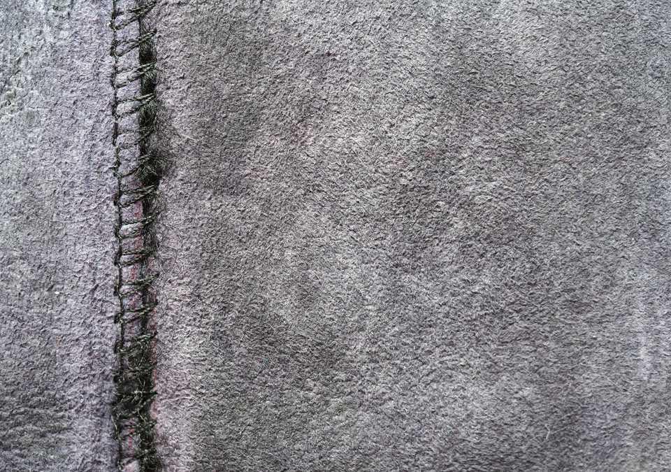 Zigzag connecting seam on gray fabric