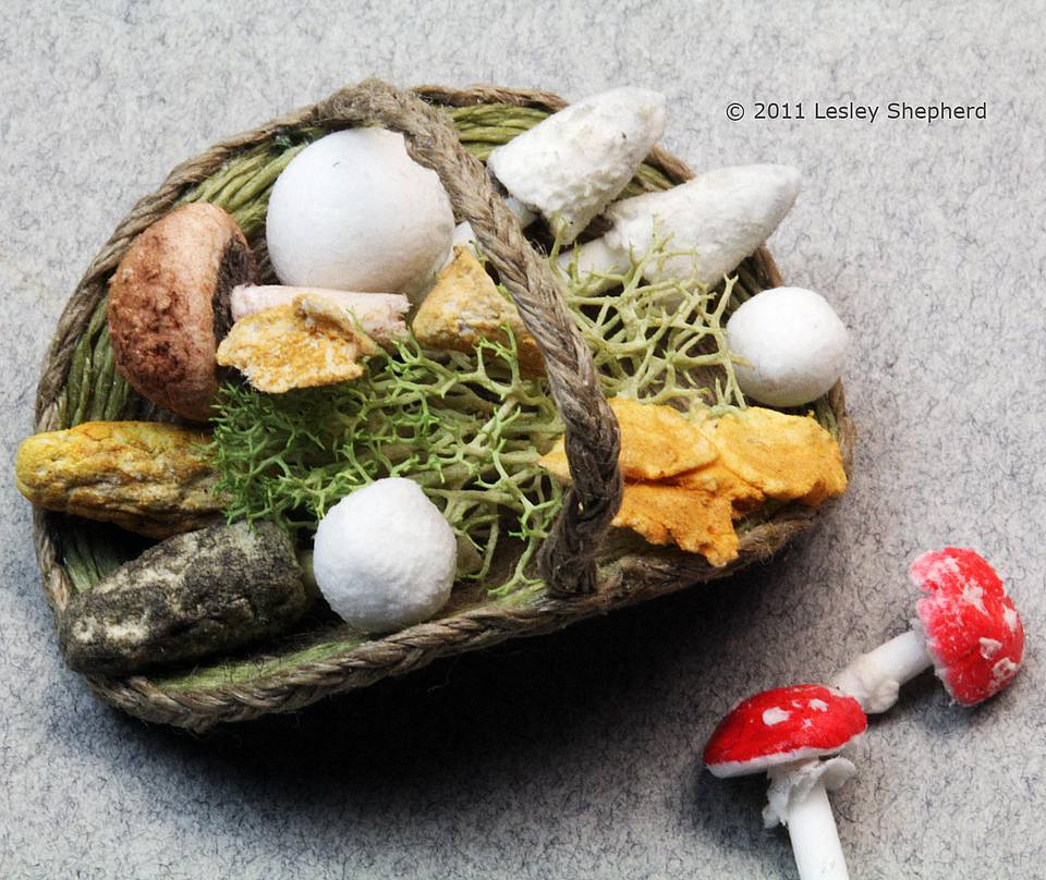Delight air dry clay mushrooms in a dollhouse basket.
