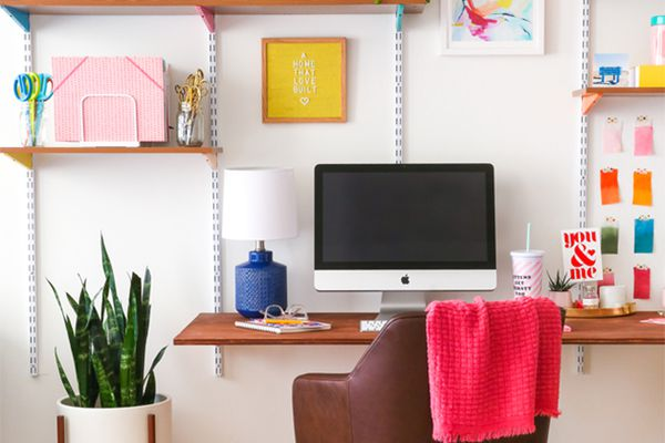 A craft desk with bookshelves